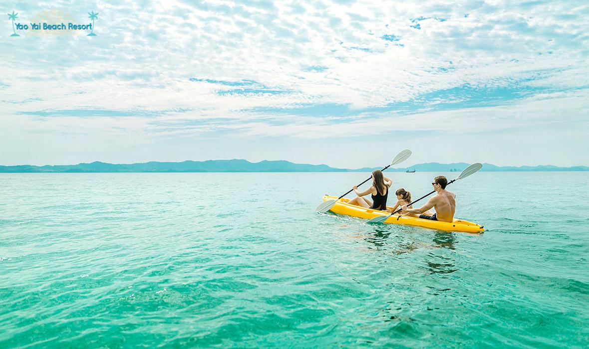 family kayaking Yao Yai Beach Resort Thailand